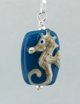 mini tan blue background sea horse